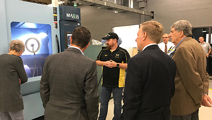 Donors and community partners view a demonstration of the new Matsuura Industries five-axis mill at Anoka Technical College. Acquisition of the state-of-the-art technology was made possible through corporate, community and private funding and partnerships.