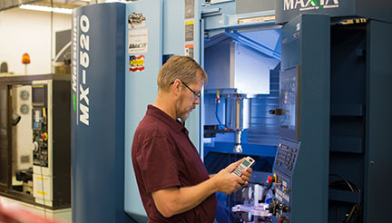 Student Paul Gustafson with Matsuura Mill