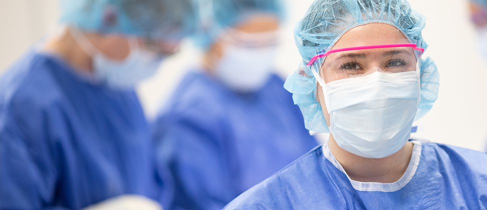 Healthcare worker wearing safety glasses and surgical mask
