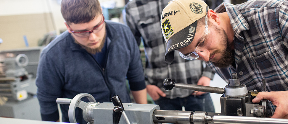 Two Students working on machine