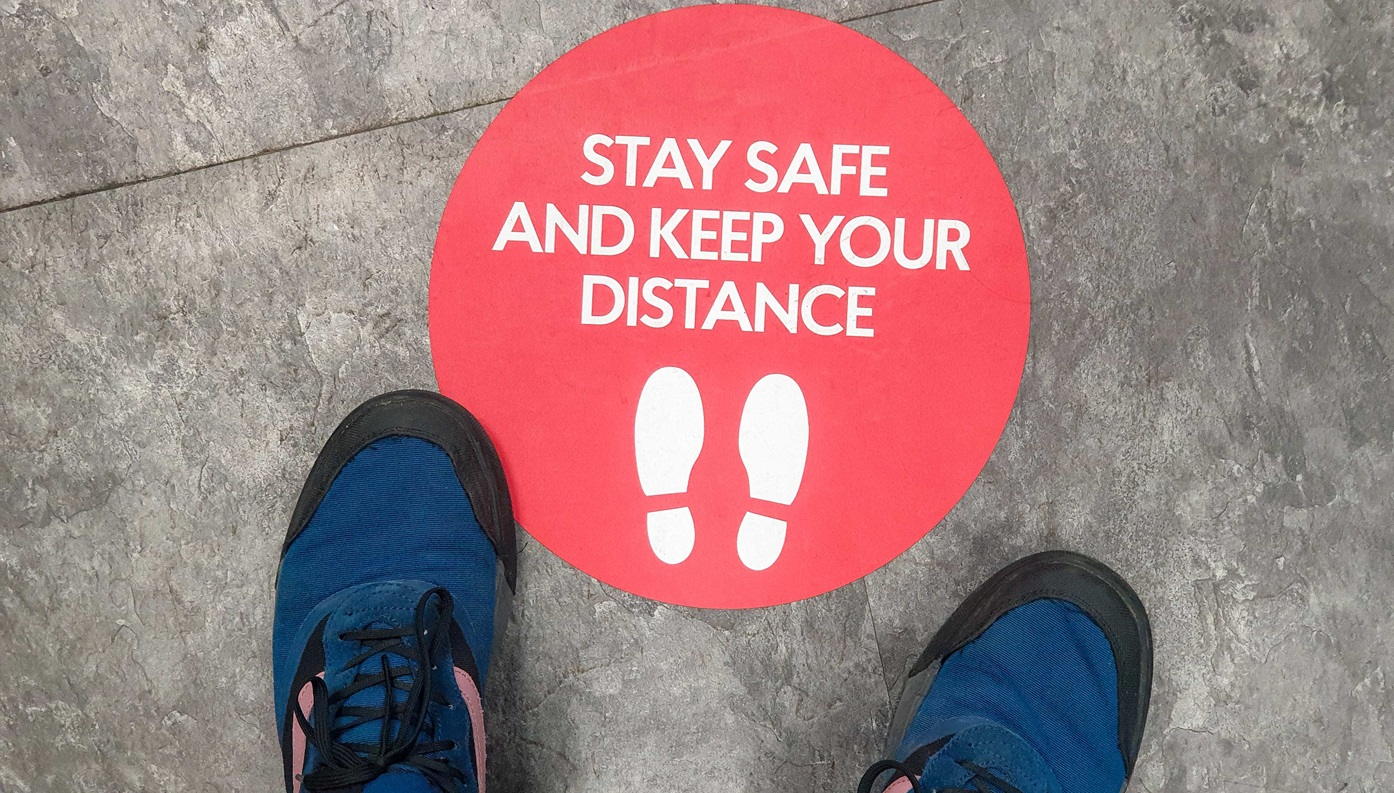Shoes on ground near stay safe sticker